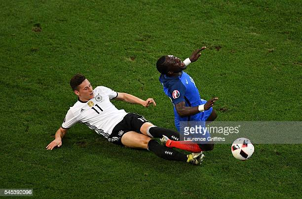 Moussa Sissoko of France is fouled by Julian Draxler of Germany during the UEFA EURO semi final match between Germany and France at Stade Velodrome...