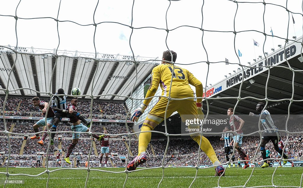 Moussa Sissoko (second from left) of Newcastle scores the opening goal during the Barclays Premier League match between Newcastle United and West Ham United at St. James' Park on May 24, 2015, in Newcastle upon Tyne, England, United Kingdom.