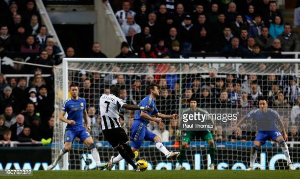 Moussa Sissoko of Newcastle shoots to score this sides third goal during the Premier League match between Newcastle United and Chelsea at St James...