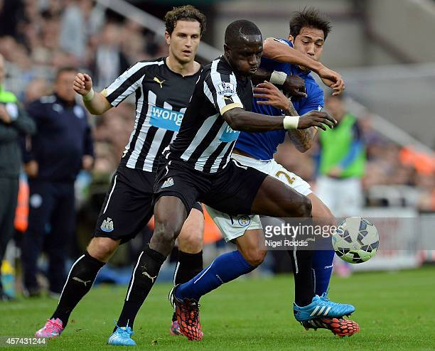 Moussa Sissoko of Newcastle United and Leonardo Ulloa of Leicester City compete for the ball during the Barclays Premier League match between...