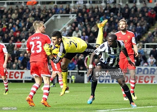 Moussa Sissoko of Newcastle United challenges goalkeeper Paulo Gazzaniga of Southampton during the Barclays Premier League match between Newcastle...