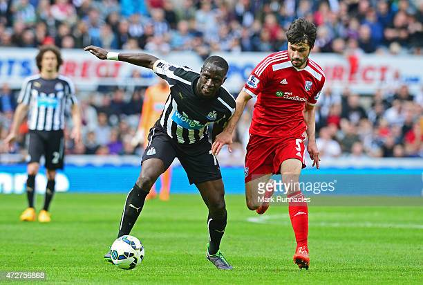 Moussa Sissoko of Newcastle United is closed down by Claudio Yacob of West Brom during the Barclays Premier League match between Newcastle United and...