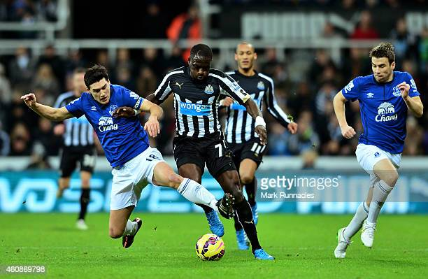 Moussa Sissoko of Newcastle United is tackled by Gareth Barry of Everton during the Barclays Premier League match between Newcastle United and...