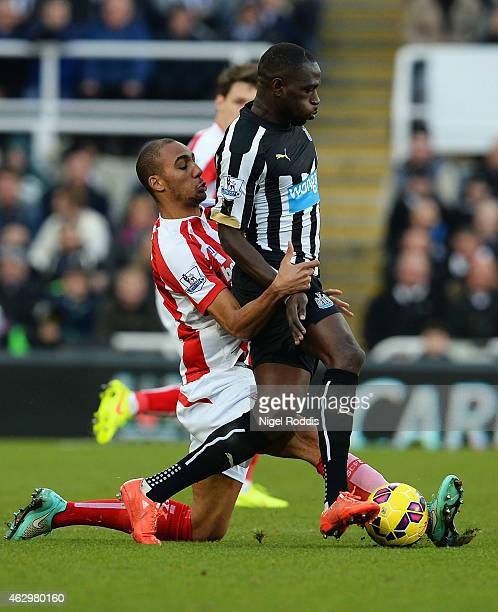 Moussa Sissoko of Newcastle United is tackled by Steven N'Zonzi of Stoke City during the Barclays Premier League match between Newcastle United and...