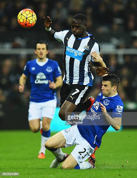 Moussa Sissoko of Newcastle United is tripped by Seamus Coleman of Everton during the Barclays Premier League match between Newcastle United and...