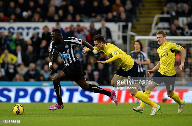 Moussa Sissoko of Newcastle United runs with the ball under pressure from Florin Gardos of Southampton during the Barclays Premier League match...