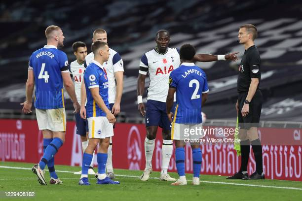 Moussa Sissoko of Spurs and Tariq Lamptey of Brighton discuss the VAR decision during the Premier League match between Tottenham Hotspur and Brighton...