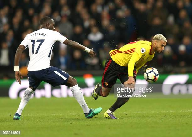 Moussa Sissoko of Tottenham fouls Etienne Capoue of Watford during the Premier League match between Tottenham Hotspur and Watford at Wembley Stadium...