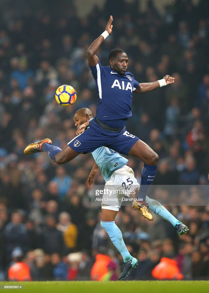 Moussa Sissoko of Tottenham Hotspur and Fernandinho of Manchester City challenge for the ball during the Premier League match between Manchester City and Tottenham Hotspur at Etihad Stadium on December 16, 2017 in Manchester, England.