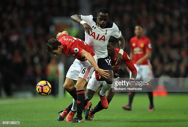 Moussa Sissoko of Tottenham Hotspur and Matteo Darmian of Manchester United compete for the ball during the Premier League match between Manchester...