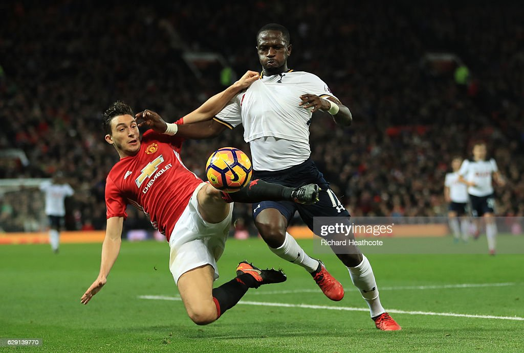 Moussa Sissoko of Tottenham Hotspur and Matteo Darmian of Manchester United compete for the ball during the Premier League match between Manchester United and Tottenham Hotspur at Old Trafford on December 11, 2016 in Manchester, England.