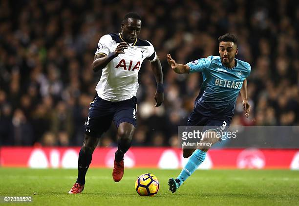 Moussa Sissoko of Tottenham Hotspur and Neil Taylor of Swansea City compete for the ball during the Premier League match between Tottenham Hotspur...