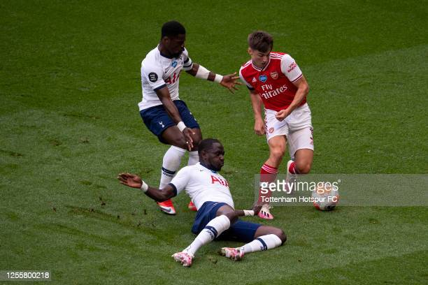 Moussa Sissoko of Tottenham Hotspur and Serge Aurier of Tottenham Hotspur battle for possession with Kieran Tierney of Arsenal during the Premier...