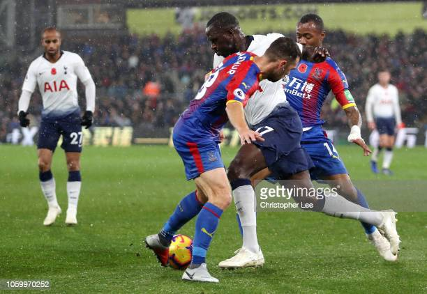 Moussa Sissoko of Tottenham Hotspur battles for possession with Jordan Ayew and James McArthur of Crystal Palace during the Premier League match...
