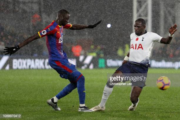Moussa Sissoko of Tottenham Hotspur battles for possession with Cheikhou Kouyate of Crystal Palace during the Premier League match between Crystal...