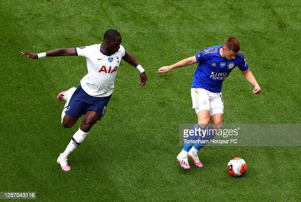 Moussa Sissoko of Tottenham Hotspur battles for possession with Harvey Barnes of Leicester City during the Premier League match between Tottenham...