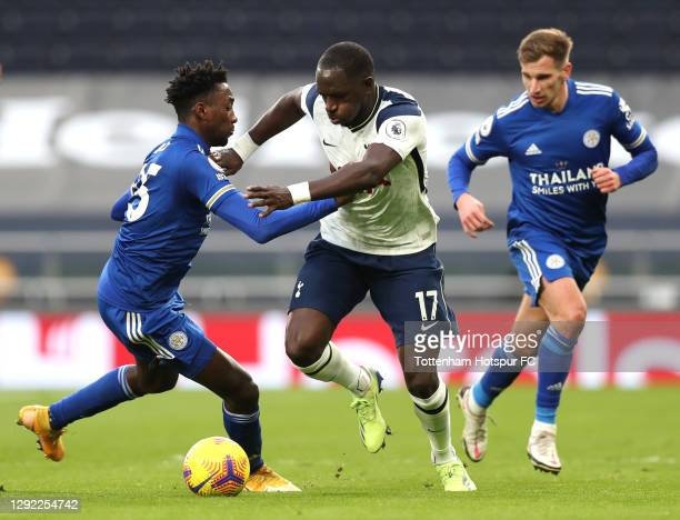 Moussa Sissoko of Tottenham Hotspur breaks past Wilfred Ndidi of Leicester City during the Premier League match between Tottenham Hotspur and...