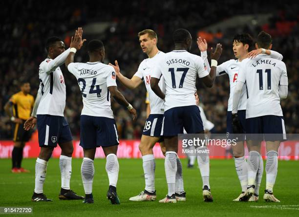Moussa Sissoko of Tottenham Hotspur celebrates his sides first goal with his team mates after his cross was deflected in by Dan Butler of Newport...