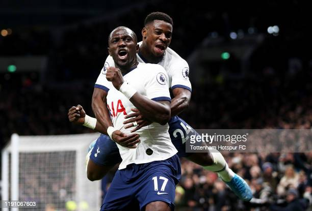 Moussa Sissoko of Tottenham Hotspur celebrates with teammate Serge Aurier after scoring his team's third goal during the Premier League match between...