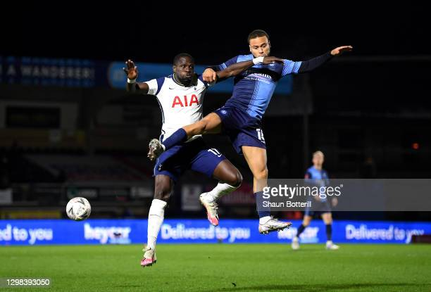 Moussa Sissoko of Tottenham Hotspur challenges for the high ball with Curtis Thompson of Wycombe Wanderers during The Emirates FA Cup Fourth Round...