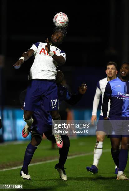 Moussa Sissoko of Tottenham Hotspur challenges for the high ball with Adebayo Akinfenwa of Wycombe Wanderers during The Emirates FA Cup Fourth Round...