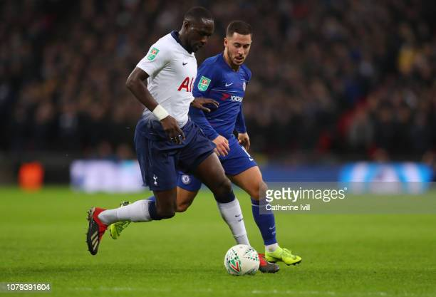 Moussa Sissoko of Tottenham Hotspur competes with Eden Hazard of Chelsea during Carabao Cup SemiFinal between Tottenham Hotspur and Chelsea at...