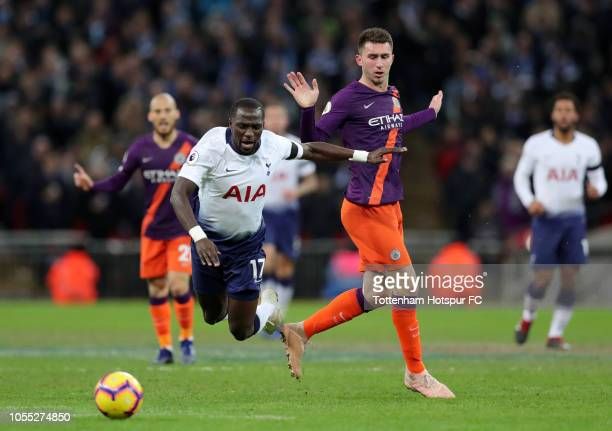 Moussa Sissoko of Tottenham Hotspur is challenged by Aymeric Laporte of Manchester City during the Premier League match between Tottenham Hotspur and...