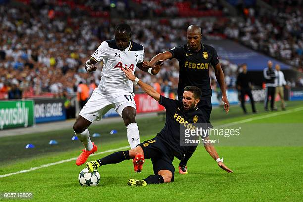 Moussa Sissoko of Tottenham Hotspur is challenged by Joao Moutinho of AS Monaco during the UEFA Champions League match between Tottenham Hotspur FC...