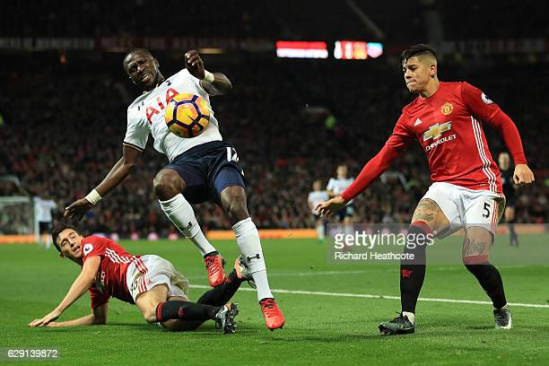 Moussa Sissoko of Tottenham Hotspur is challenged by Matteo Darmian of Manchester United during the Premier League match between Manchester United...
