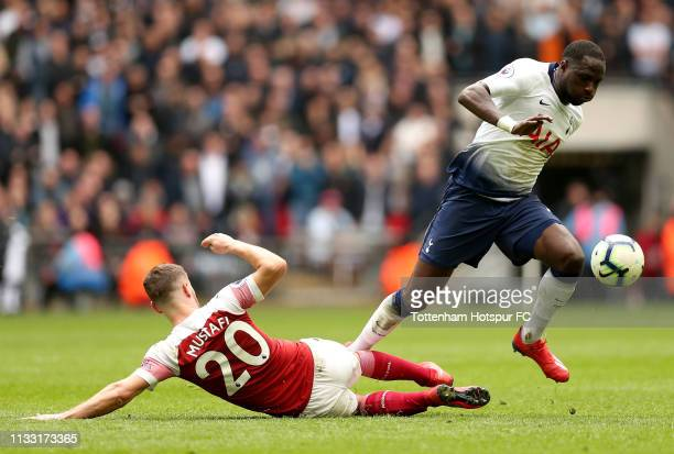 Moussa Sissoko of Tottenham Hotspur is challenged by Shkodran Mustafi of Arsenal during the Premier League match between Tottenham Hotspur and...