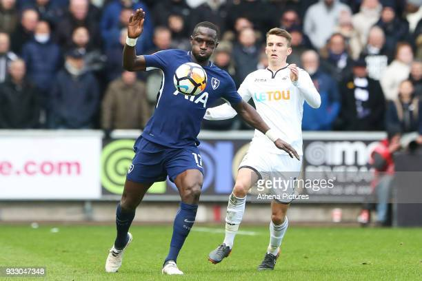 Moussa Sissoko of Tottenham Hotspur is marked by Tom Carroll of Swansea during the Fly Emirates FA Cup Quarter Final match between Swansea City and...