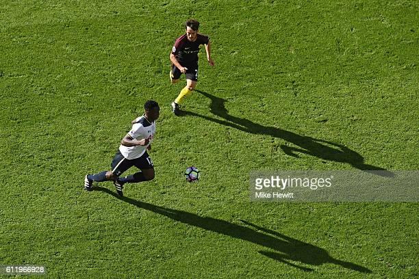 Moussa Sissoko of Tottenham Hotspur is put under pressure from David Silva of Manchester City during the Premier League match between Tottenham...
