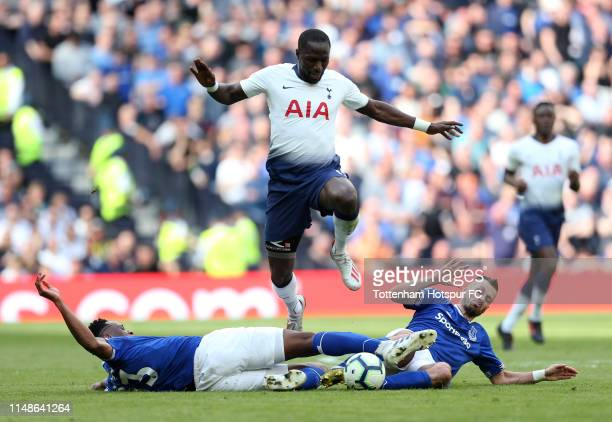 Moussa Sissoko of Tottenham Hotspur is tackled by Yerry Mina and Morgan Schneiderlin of Everton during the Premier League match between Tottenham...