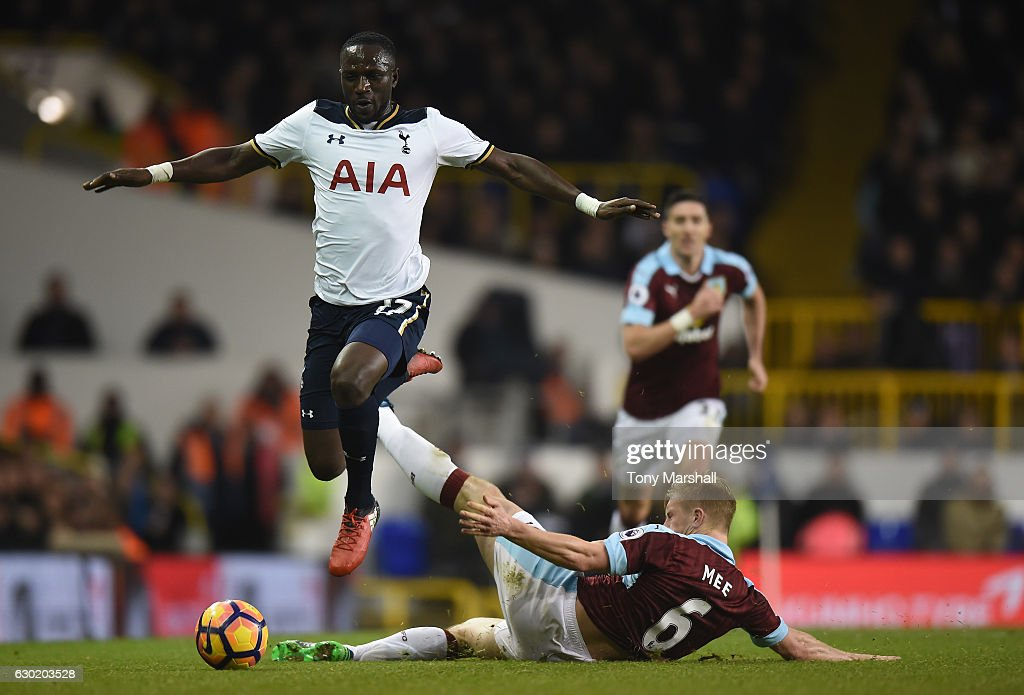 Moussa Sissoko of Tottenham Hotspur (L) jumps over Ben Mee of Burnley (R) challenge during the Premier League match between Tottenham Hotspur and Burnley at White Hart Lane on December 18, 2016 in London, England.