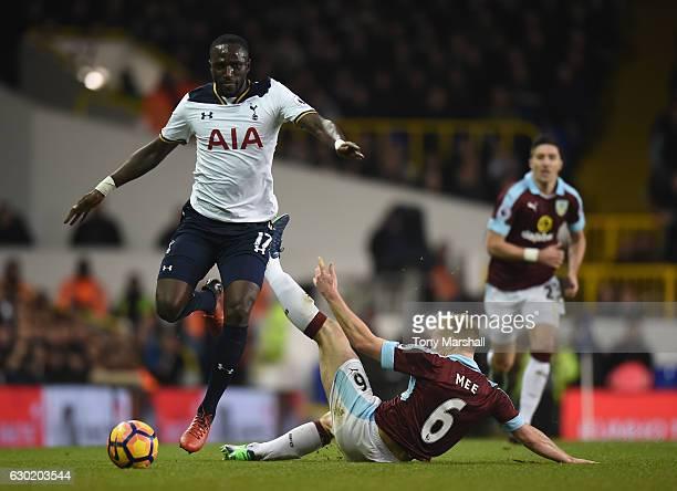 Moussa Sissoko of Tottenham Hotspur jumps over Ben Mee of Burnley challenge during the Premier League match between Tottenham Hotspur and Burnley at...