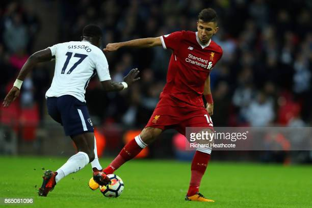 Moussa Sissoko of Tottenham Hotspur puts pressure on Marko Grujic of Liverpool during the Premier League match between Tottenham Hotspur and...