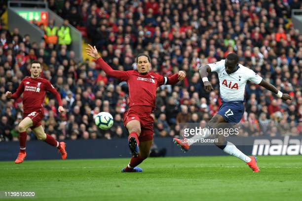 Moussa Sissoko of Tottenham Hotspur shoots wide under pressure from Virgil Van Dijk of Liverpool during the Premier League match between Liverpool FC...