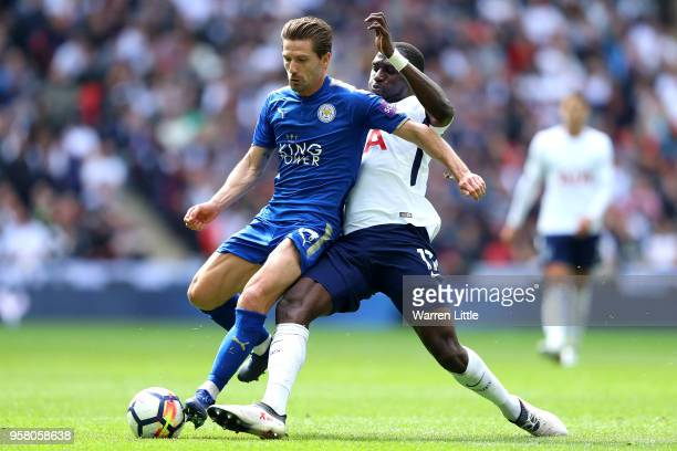 Moussa Sissoko of Tottenham Hotspur tackles Adrien Silva of Leicester City during the Premier League match between Tottenham Hotspur and Leicester...