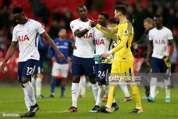 Moussa Sissoko of Tottenham Hotspur talks to teammates Serge Aurier and Hugo Lloris after the Premier League match between Tottenham Hotspur and...