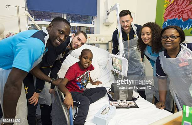 Moussa Sissoko Pau Lopez Hugo Lloris and Leah Rawle of Tottenham Hotspur hand out presents to patients at Whipps Cross Hospital on December 21 2016...