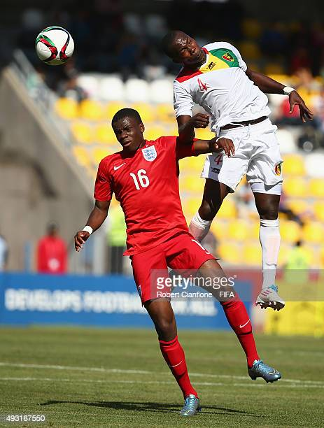 Moussa Soumah of Guinea head the ball over Stephy Mavididi of England during the FIFA U17 World Cup Group B match between England and Guinea at...