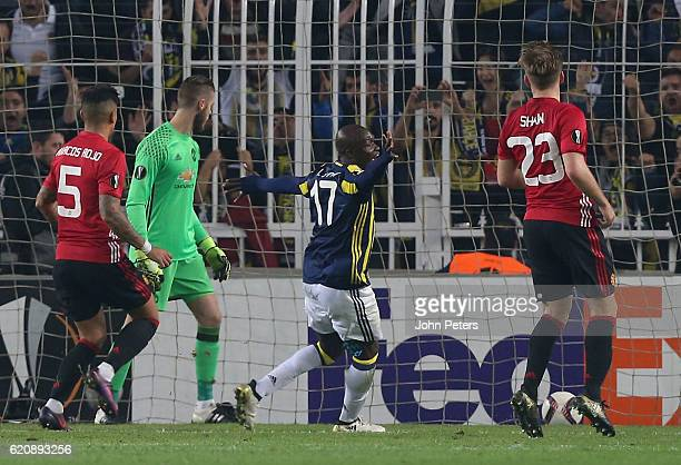 Moussa Sow of Fenerbahce celebrates Jermaine Lens scoring their second goal during the UEFA Europa League match between Manchester United and...