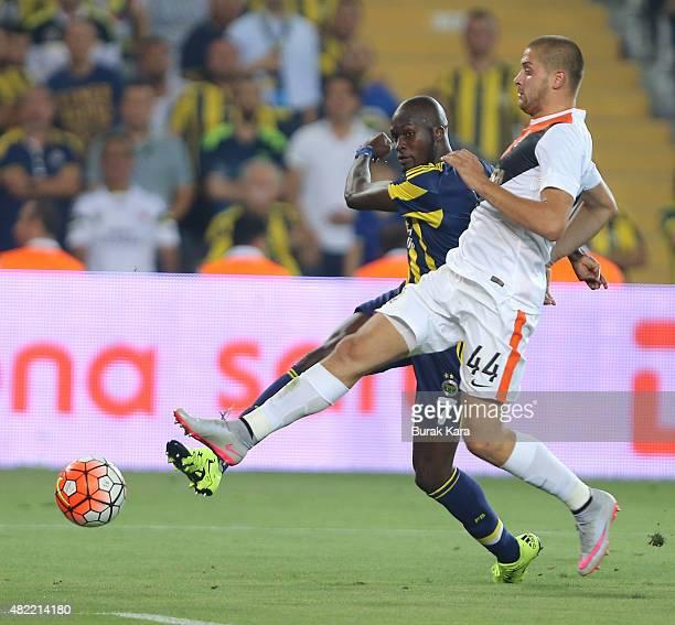 Moussa Sow of Fenerbahce is in action with Yaroslav Rakitskiy of Shaktar Donetsk during UEFA Champions League Third Qualifying Round 1st Leg match...