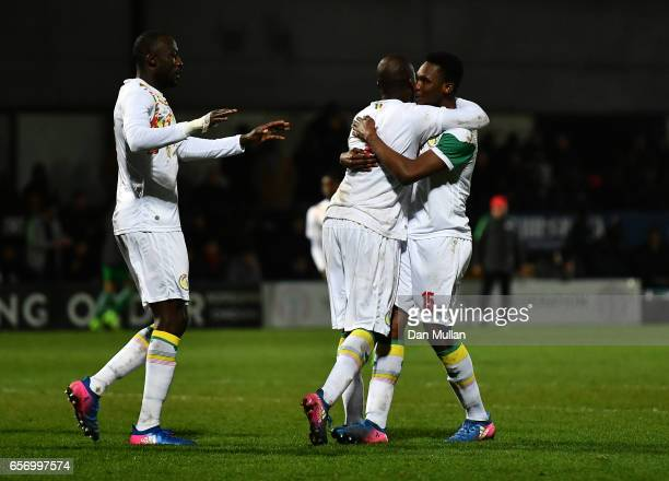 Moussa Sow of Senegal celebrates with his team mates after scoring his side's first goal during the International Friendly match between Nigeria and...