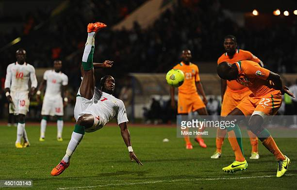 Moussa Sow of Senegal tries an overhead shot as Souleman Bamba of Ivory Coast tries to block during the FIFA 2014 World Cup Qualifier Playoff Second...