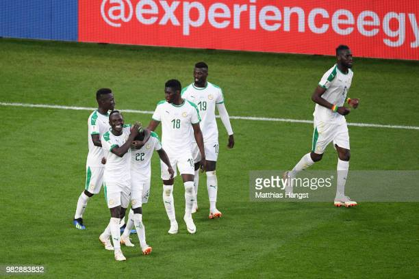 Moussa Wague of Senegal celebrates with teammate Sadio Mane after scoring his team's second goal during the 2018 FIFA World Cup Russia group H match...