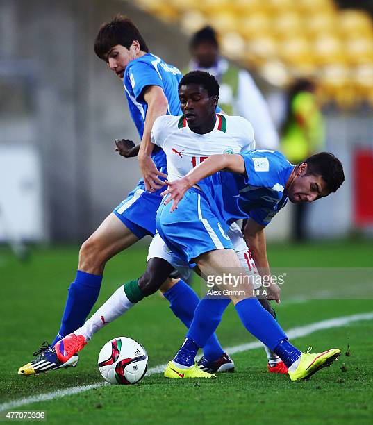 Moussa Wague of Senegal is challenged by Eldor Shomurodov and Akramjon Komilov of Uzbekistan during the FIFA U20 World Cup New Zealand 2015 Quarter...