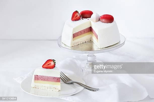 Mousse cake with white velvet covering