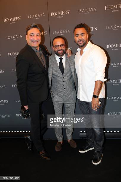 Mousse T Bardia Torabi General Manager Roomers Munich and Soccer player Patrick Owomoyela during the grand opening of Roomers IZAKAYA on October 12...