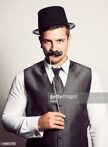 moustache man - dress hat stock pictures, royalty-free photos & images